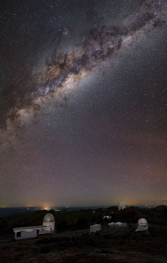 The Milky Way arcs above the Siding Spring Observatory in the Australian state of New South ...