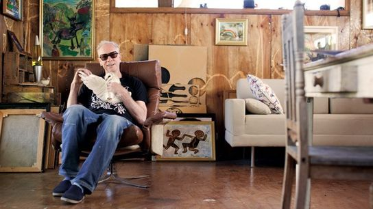 Artist Driller in his studio with his pet barn owl.