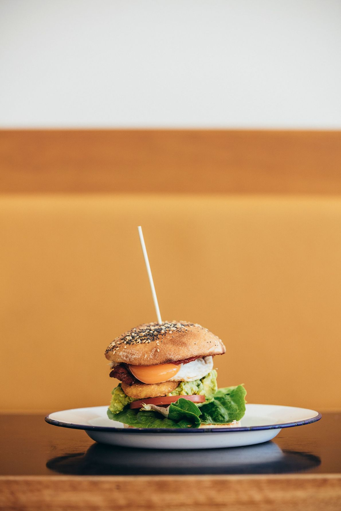 The B.O.M burger at The Bottle of Milk in Lorne, comprising prime beef, cheese, bacon, egg, ...