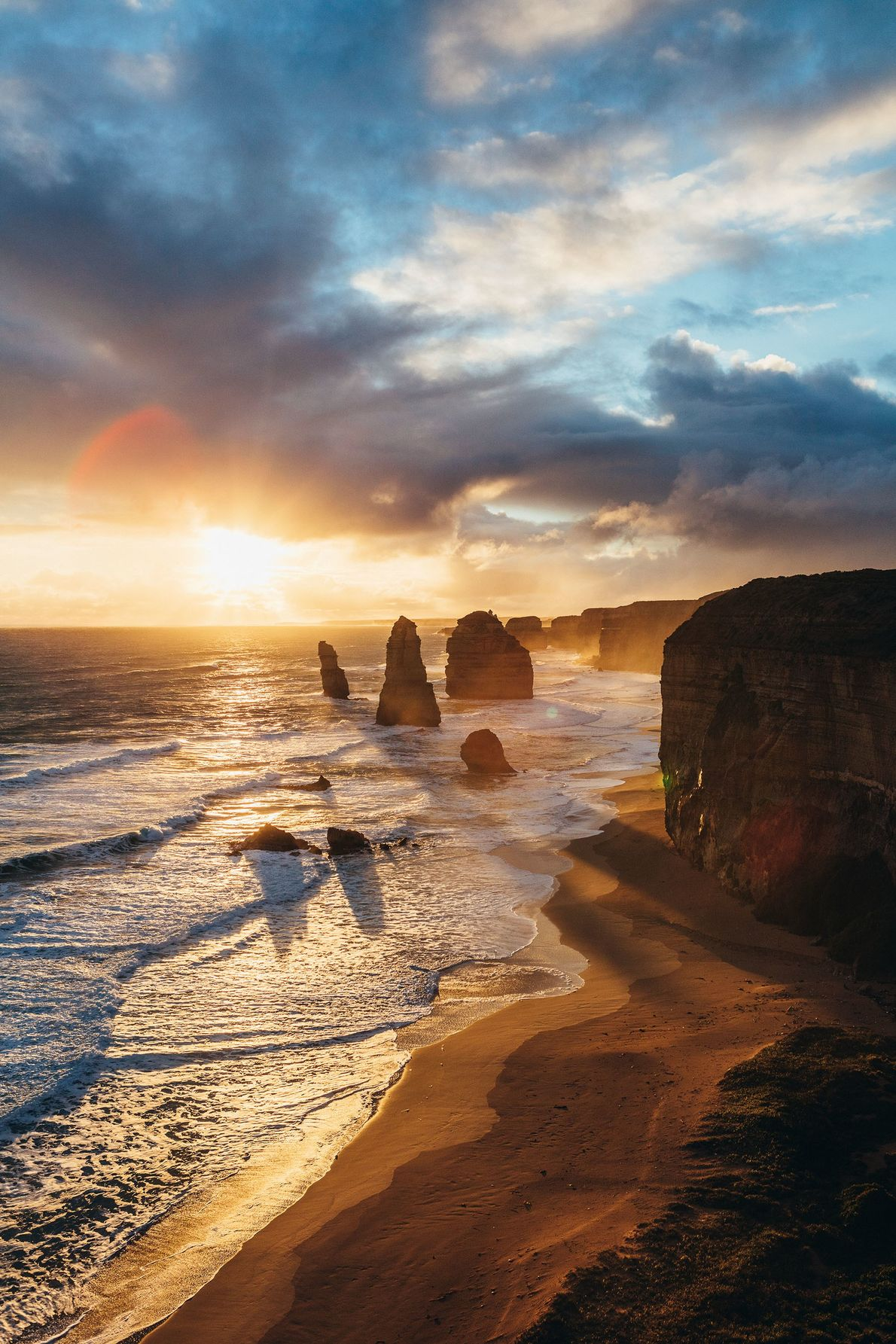 Sunset at the Twelve Apostles, a collection of limestone pillars located just off the shore between ...