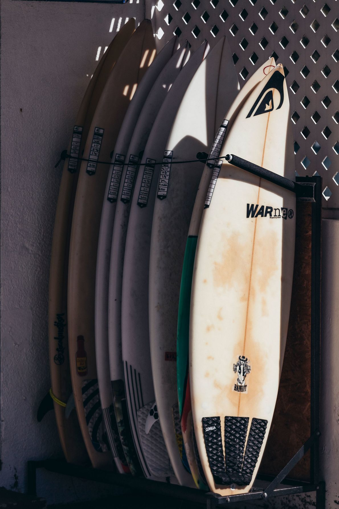 A rack of second-hand surfboards for sale in Port Fairy, one of the westernmost towns on ...