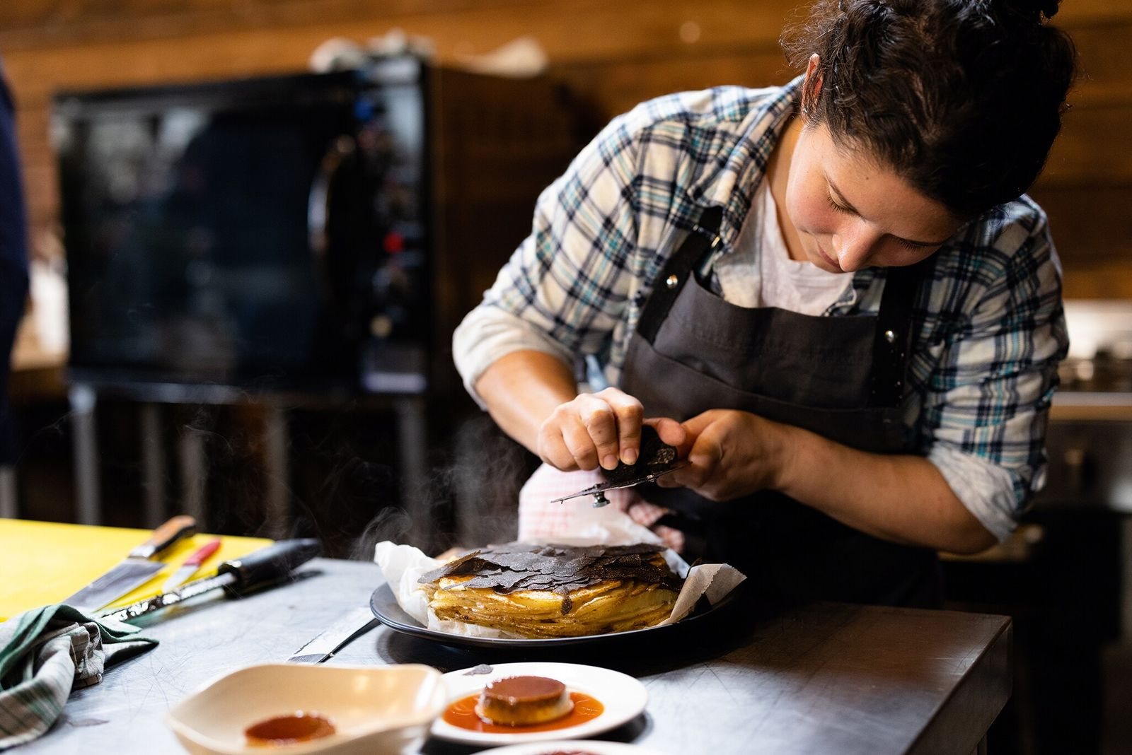 Analiese Gregory shaves truffle over a galette of locally grown Neptune potatoes.