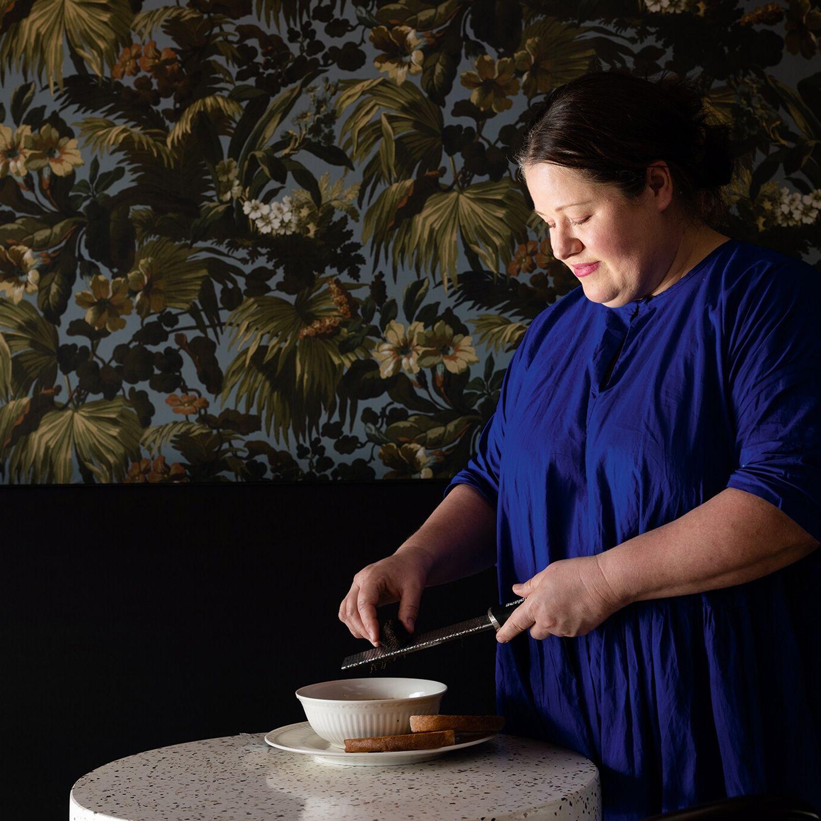 Wild at Heart's Lisa Cudby grates fresh truffle onto seasonal cauliflower and apple soup.