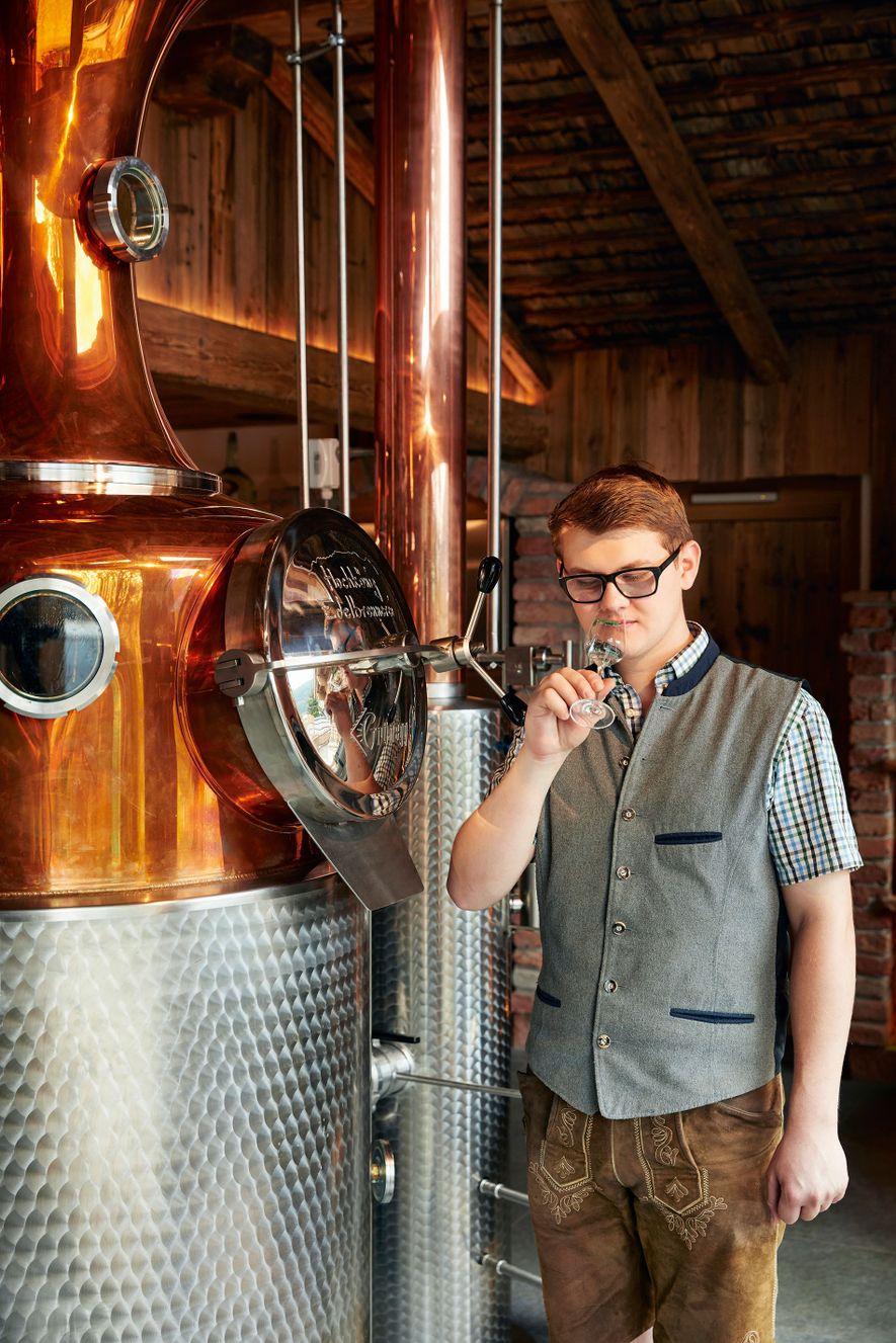 Master gin- and schnaps-maker Johannes Rainer tastes his award-winningschnaps