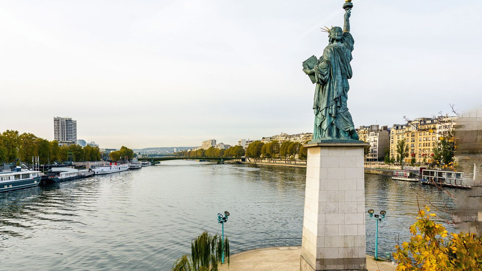 Statue of Liberty overlooking the River Seine