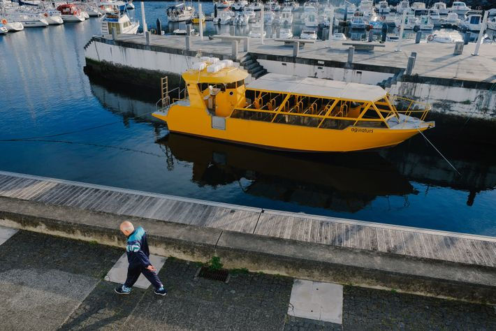 A boat normally used for tourist excursions floats idly in the Angra do Heroísmo marina.