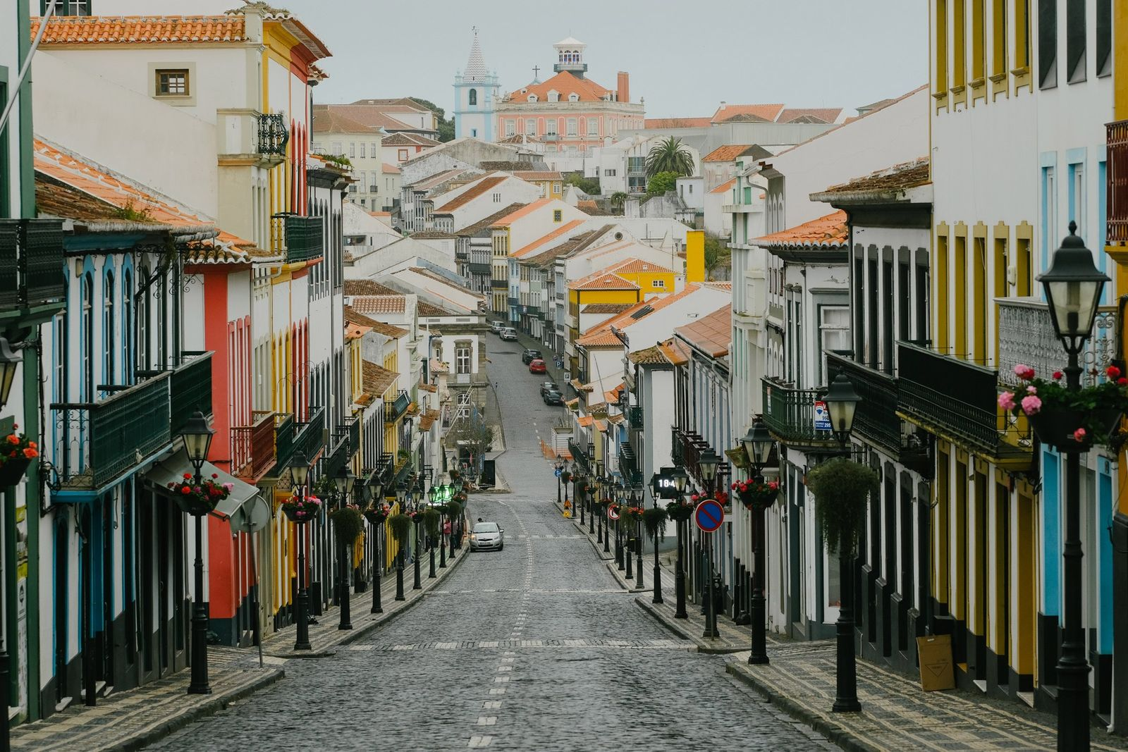On April 3, 2020, the main street of Angra do Heroísmo hosts cheery flowers but few ...