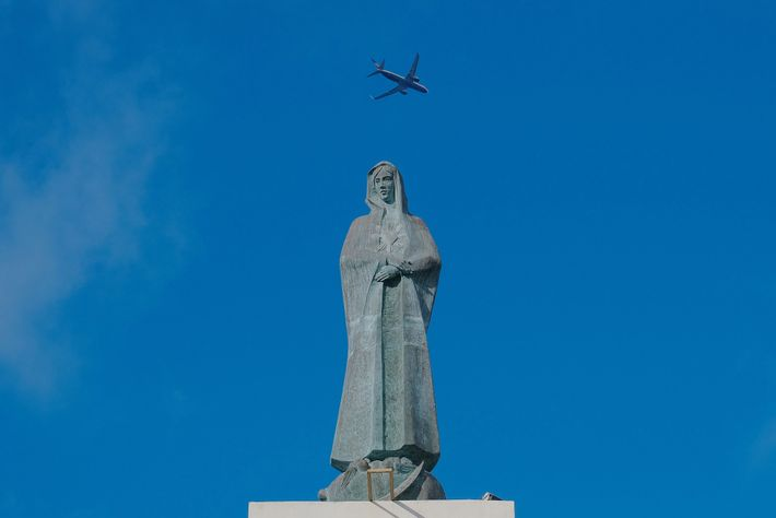 A plane leaving Lajes International Airport on Terceira Island soars above the Immaculate Heart of Mary ...
