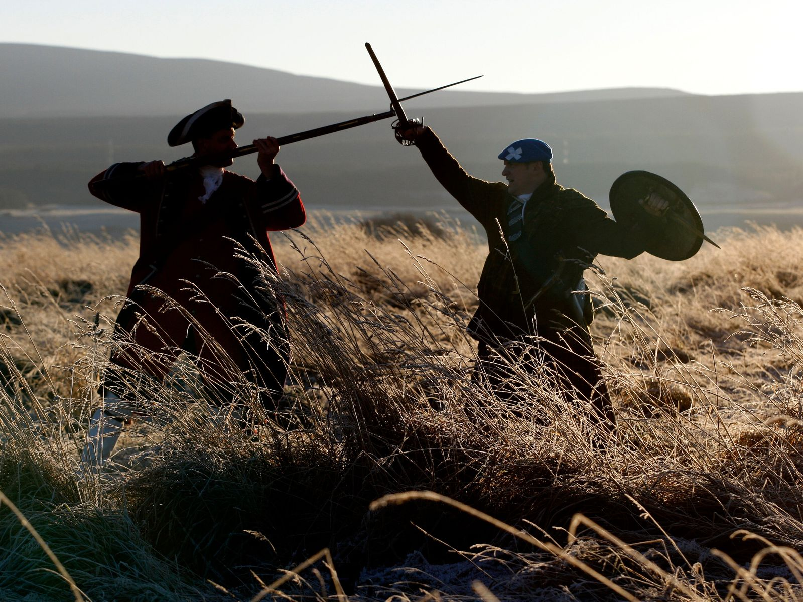 A 'redcoat officer' and a Jacobite clansman in a re-enactment of a battle on the site ...