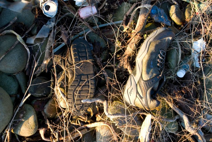 Discarded trainers on a beach in Donegal. Many plastic-derived shoes only cover your feet for a ...