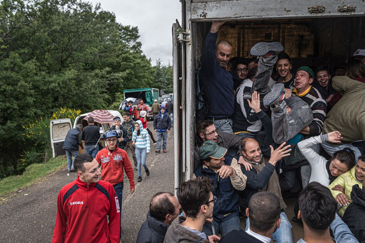 Locals pile into a truck that will take them to the Gallipoli Cognato forest where the ...