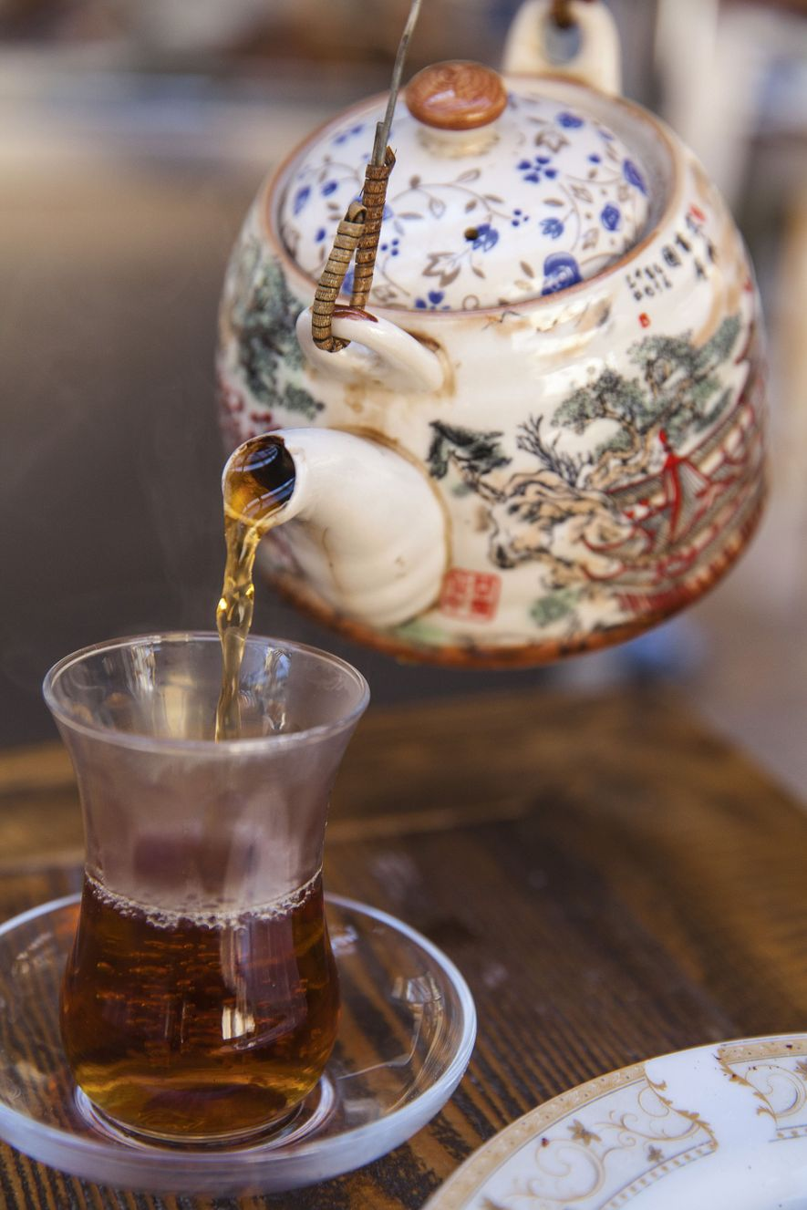 Tea being poured into an armudu — a traditional glass made to keep tea cool on ...