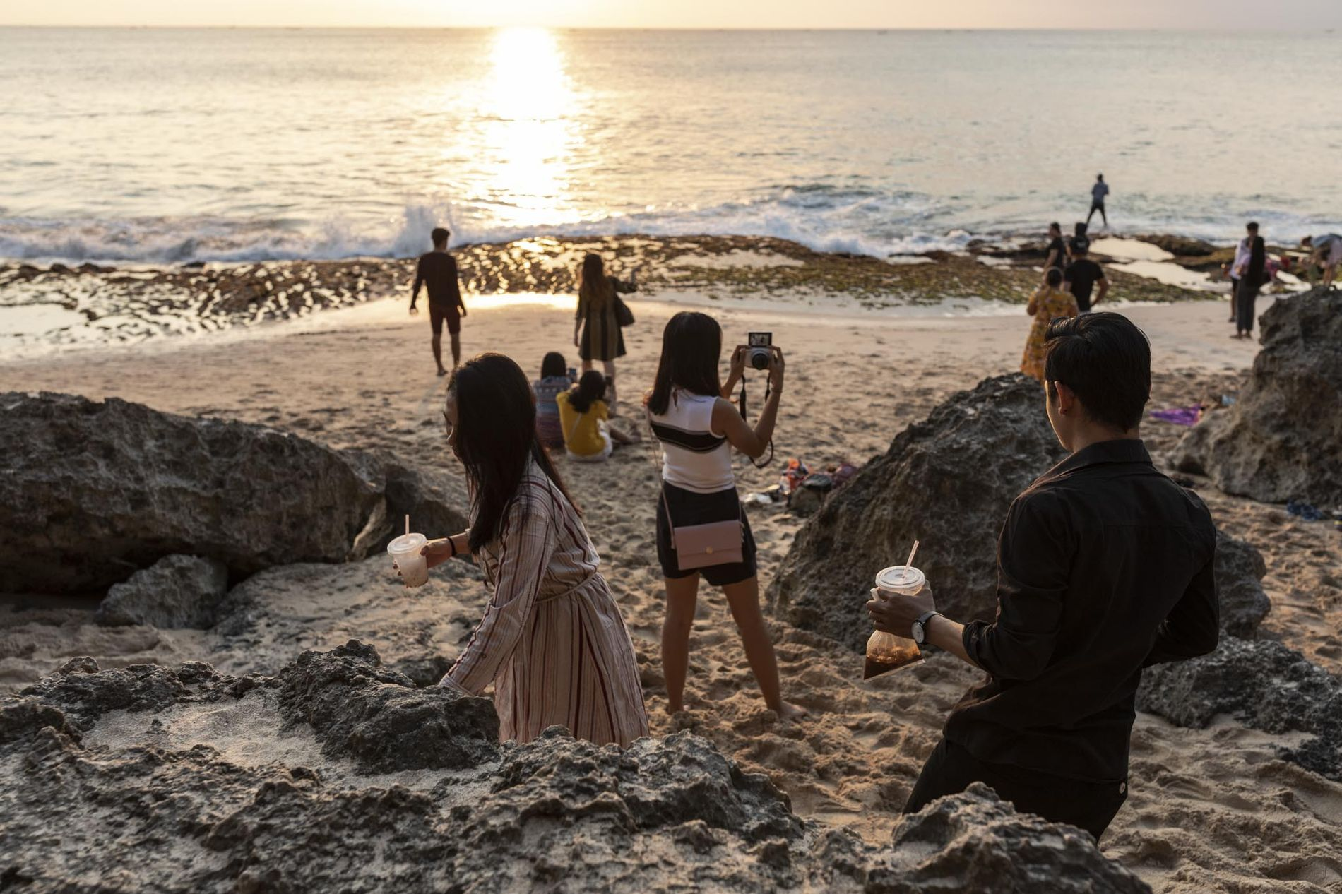 Visitors often bring snacks to Tegal Wangi beach to enjoy while watching the sunset, yet often ...