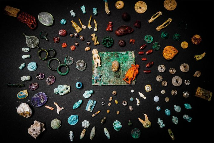 A wondrous wooden box filled with charms, ornaments, and figurines was found in the House of ...