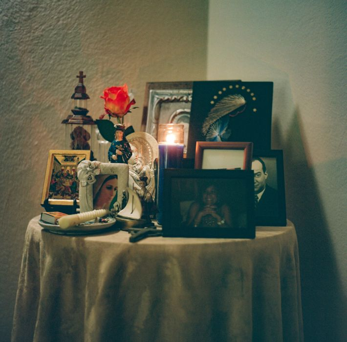 Cristina Baussan's grandmother's altar in 2021. Every day, Myrto takes a moment to light candles on ...
