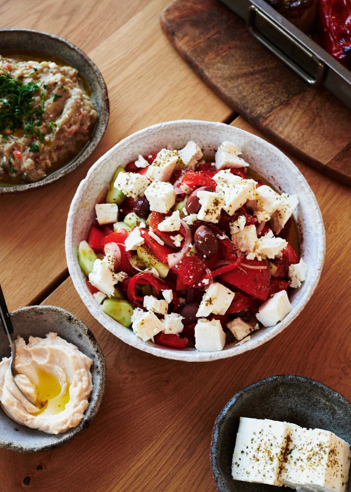Bowls of Greek salad, feta, hummus and melitzanosalata.