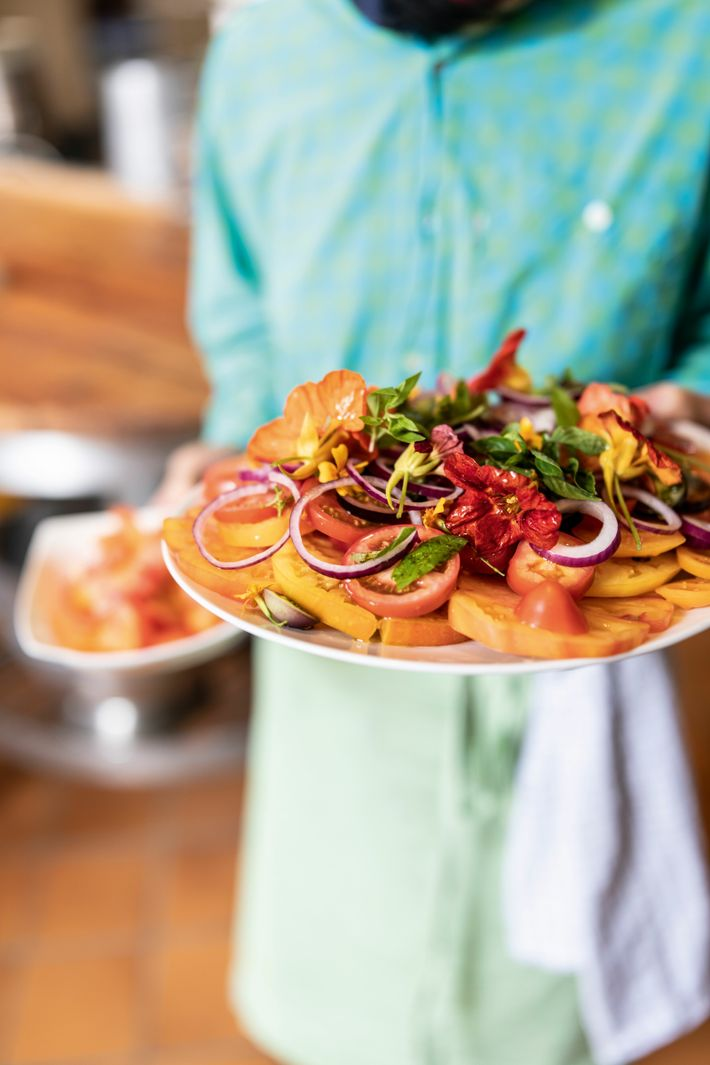 Tomato salad with herbs and onions. All of these ingredients were grown in the garden of ...