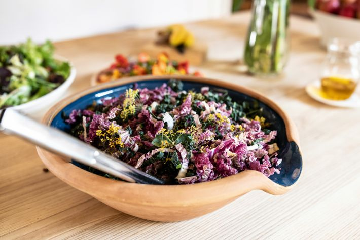 Kale (also known as palmekål) and lettuce salad garnished with fennel flowers.