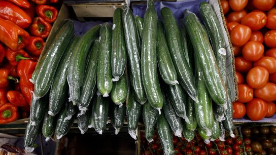 Plastic-wrapped cucumbers are displayed at a grocery store in Toronto. Food packaging made up nine out ...