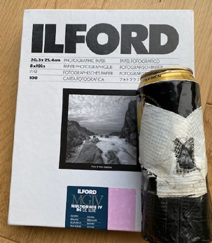 The cider can used to make the image, and a pack of Ilford photographic paper similar ...