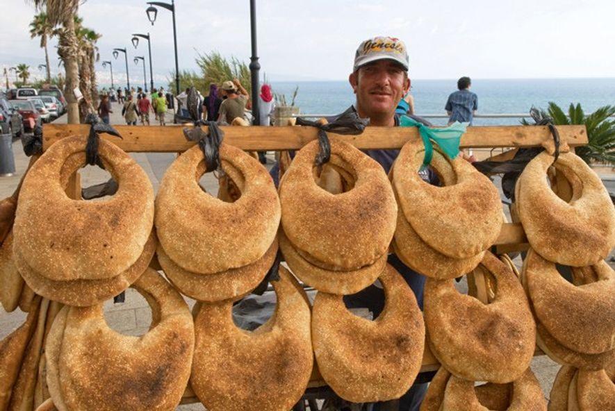 Street vendor selling ka'ik(bread with sesame seeds) along the Corniche. Image: Alamy