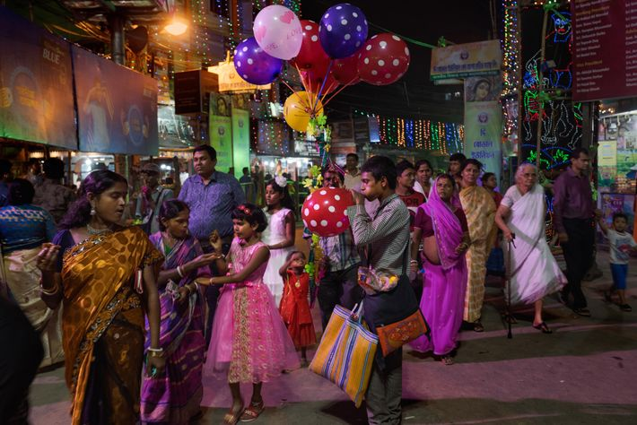 A crowd in Kolkata celebrates Durga Puja, West Bengal's most popular religious festival. Observed over nine ...