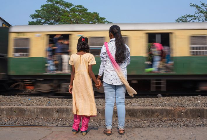 M., who is now 18, waits for a train with her cousin in South 24 Parganas, ...