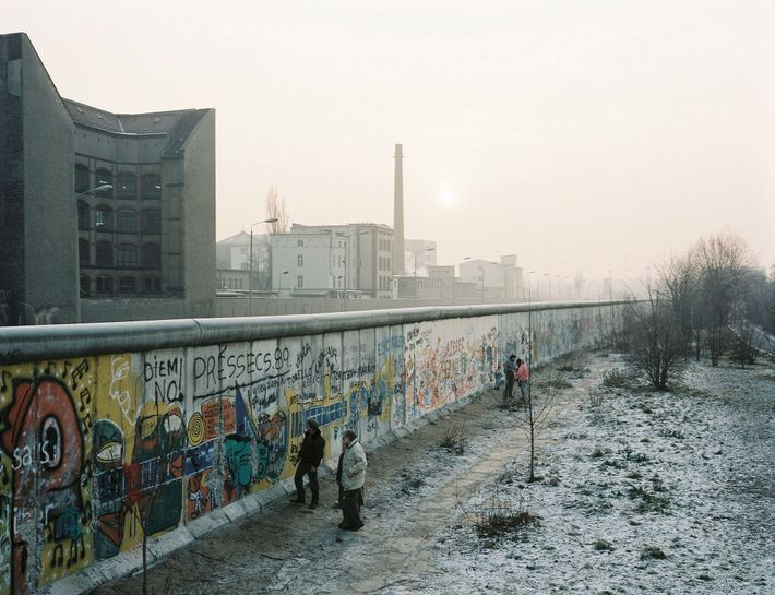 The Berlin Wall stretched for almost 27 miles across the city and employed landmines, dogs, and ...