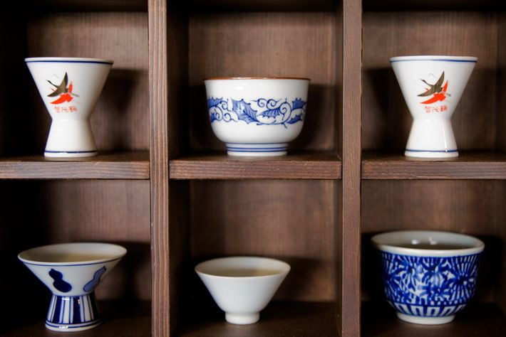 Sake was traditionally served in cups made of cedarwood, though today it's more common to drink ...
