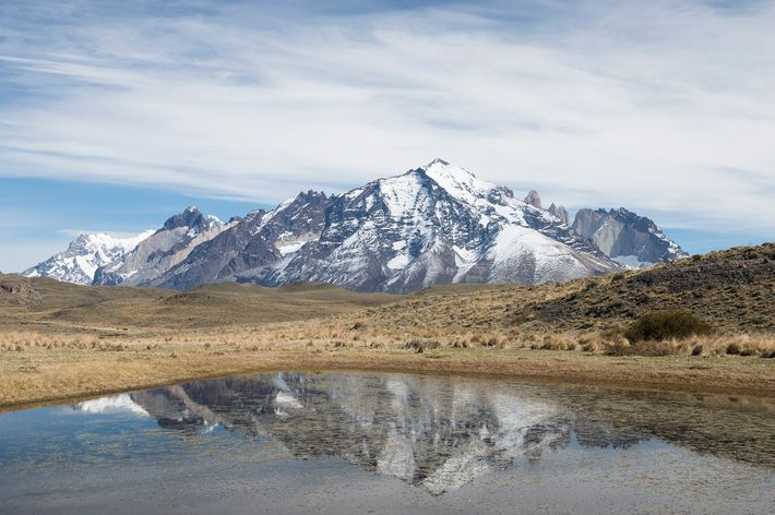 Towering mountains crown Torres del Paine National Park. The Northern Hemisphere's fall matches Patagonia's spring, where ...