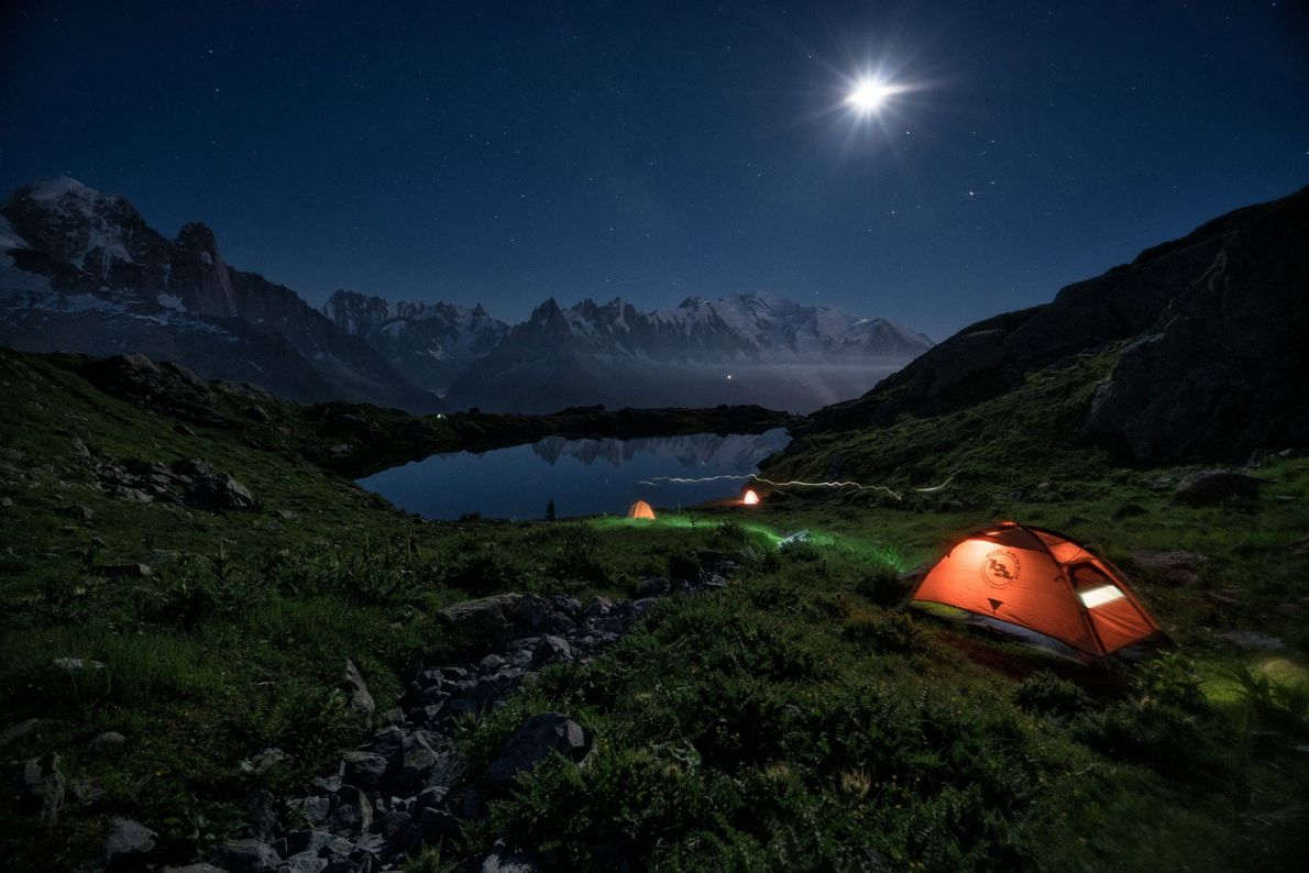 Campers sleep under the stars in Auvergne-Rhône-Alpes, France, along the GR5. The Grande Randonnée, or 'great ...