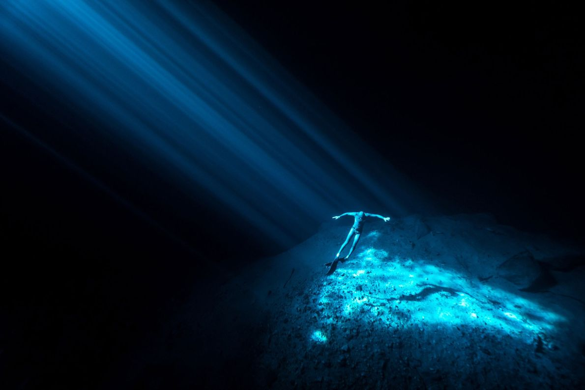 A freediver floats inside Nay Yah Cenote, an underwater sinkhole on Mexico's Yucatan Peninsula.
