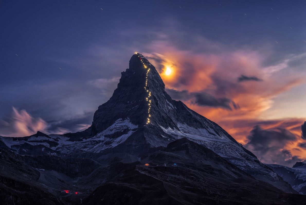 Matterhorn mountain is illuminated for the 150th anniversary of the peak's first ascent. The path was ...
