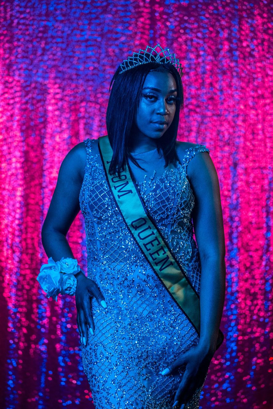 The Prom Queen, Cha'Leyah Fleming, a senior at Northwestern High School in Flint, Michigan, poses for ...