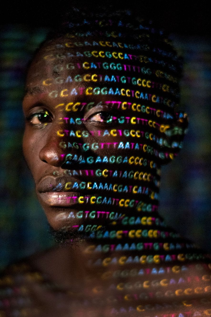The four letters of the genetic code —A, C, G, and T—are projected onto Ryan Lingarmillar, ...