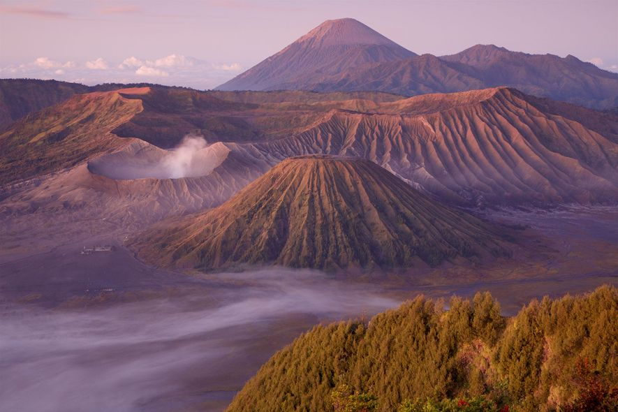 Clouds skirt Mount Bromo, an active volcano in Java, Indonesia.