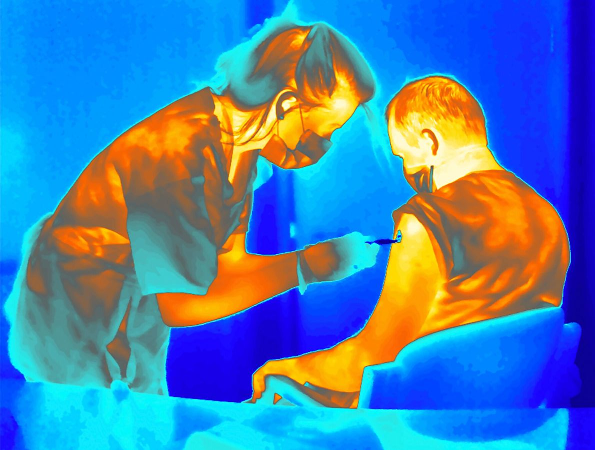 A trial volunteer is injected with a refrigerated COVID-19 vaccine developed at the University of Oxford ...