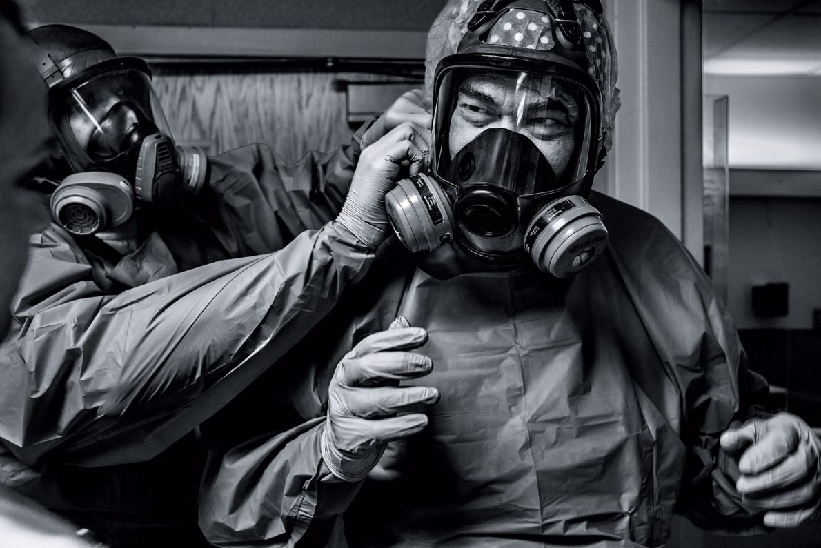Physician Gerald Foret dons a protective mask before seeing COVID-19 patients at Our Lady of the ...