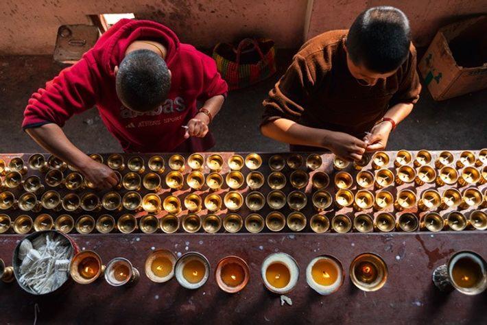 Butter lamps at Thangthong Dewachen Nunnery, Thimphu. Image: Scott A Woodward
