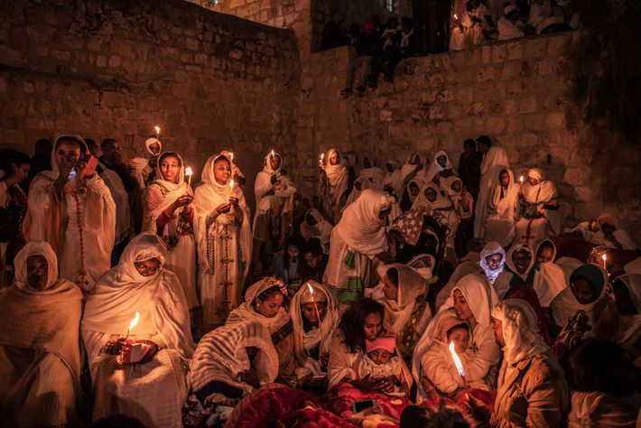 Ethiopian Orthodox pilgrims celebrate Easter atop the Church of the Holy Sepulchre. In a long dispute ...