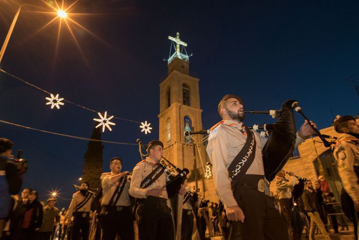 Palestinian Christians parade through the streets of Bethlehem at Christmas, which different denominations celebrate on different ...