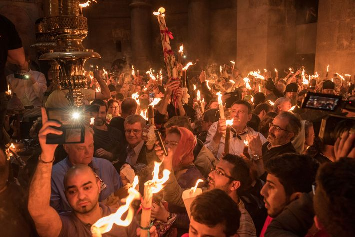 Worshippers on Holy Saturday, the day before Easter, celebrate the Miracle of the Holy Fire at ...