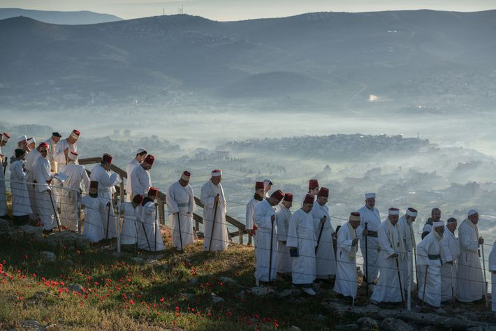 During Passover, Samaritan men walk to the top of Mount Gerizim—the site, they believe, of God's ...