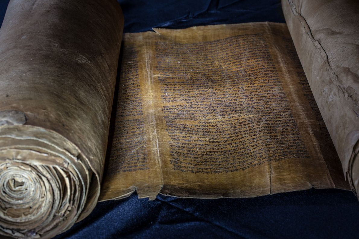 On this Torah scroll, which is hundreds of years old, a passage from the book of ...