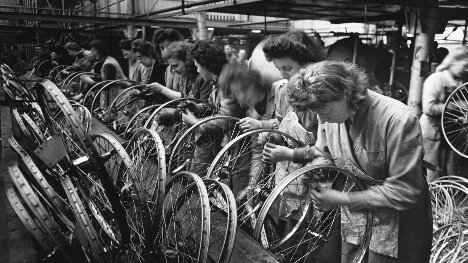 Women workers build bicycle wheels at the Hercules Cycle factory in Birmingham, England in the 1940s. ...