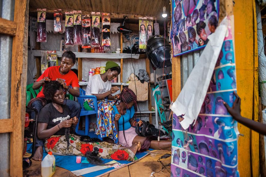 Knight Mai (left) and Florence Stima (right), who are South Sudanese, work at a salon in ...