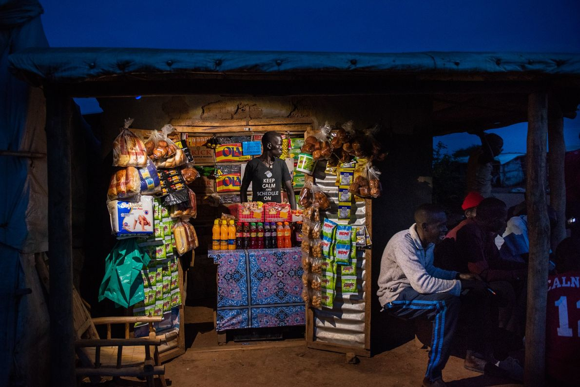 In Uganda's Bidibidi refugee camp, markets become lively meeting places after dark. Kennedy Lemmy, a 22-year-old ...