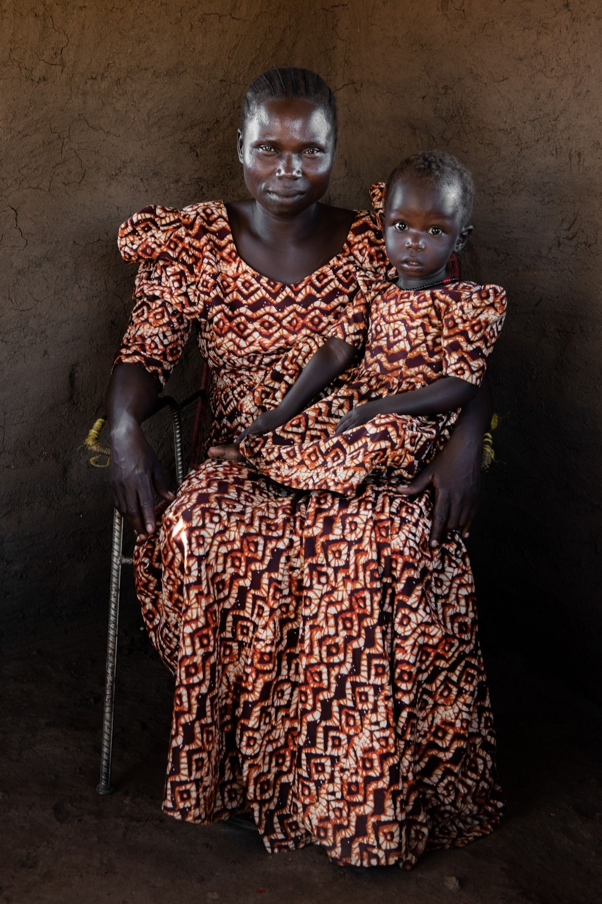 In South Sudan, Rose Asha Sillah, shown with her daughter, helped start a timber company that ...