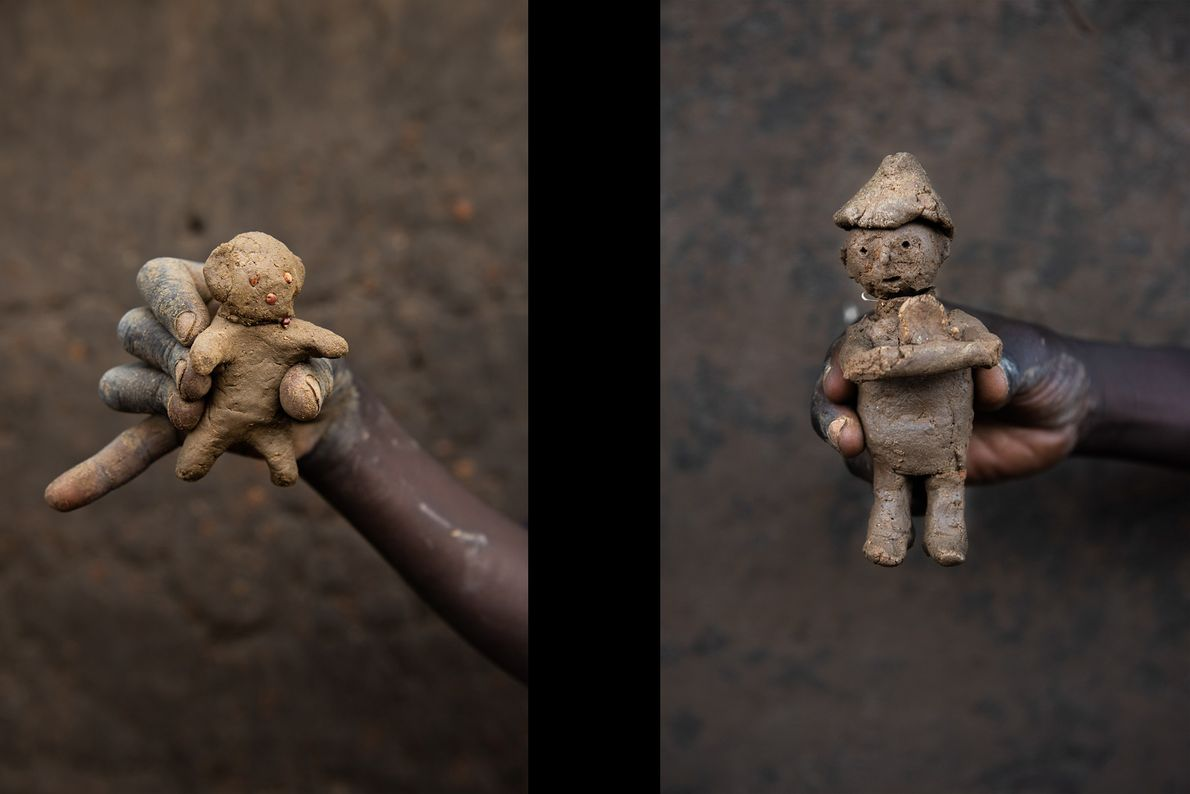 Basir's doll, pictured on the left, and a doll made by 10-year-old Abudui Ino on the ...