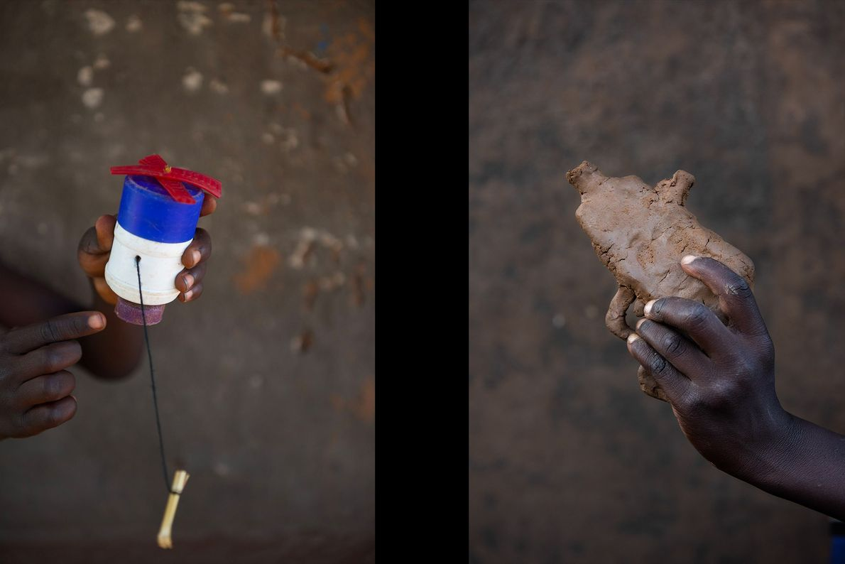 Brian Otim (left) shows off a mixer made out of plastic he found on the street ...